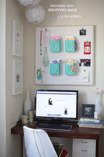 What girl doesn't love a little blue bag from Tiffany's? Now you can put those old bags you've been stockpiling to use as a bulletin board organizer.