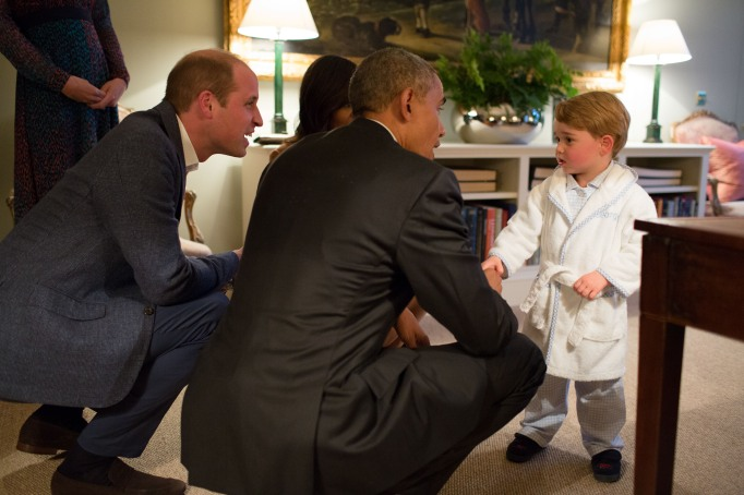 Prince George in a robe with Obama