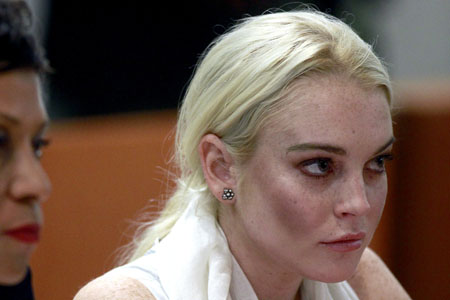 Lindsay Lohan is on crack or meth, according to her dad