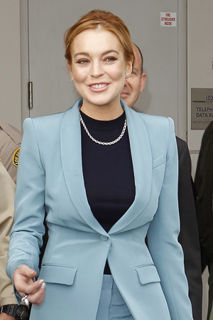 Lindsay Lohan is accused of punching another clubgoer