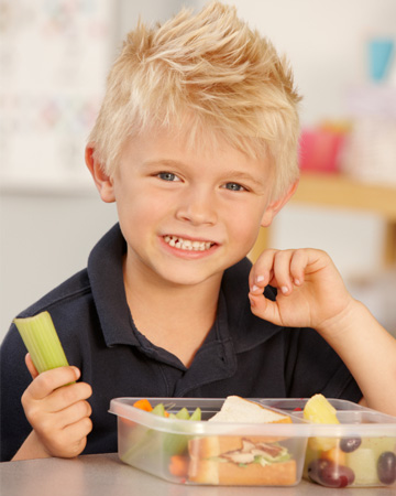 Little boy eating packed lunch