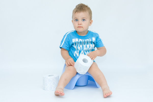 Little Boy on Potty with Toliet Paper