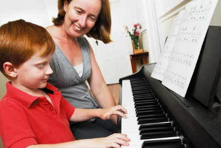 Boy taking piano lessons