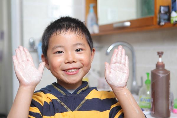 little boy washing hands