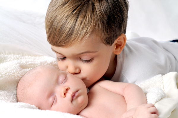 Little boy with new sibling