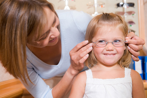 Little girl being fitted for glasses