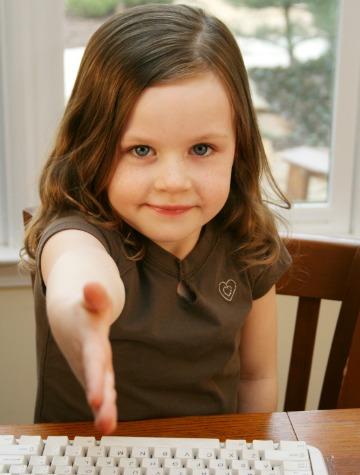 Little girl extending handshake