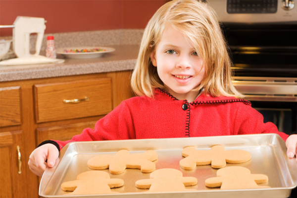 Little girl holding cookies