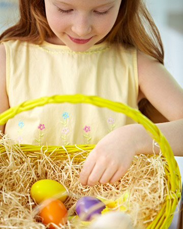 little girl looking in easter basket
