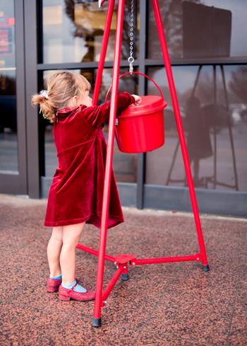 Little girl making donations