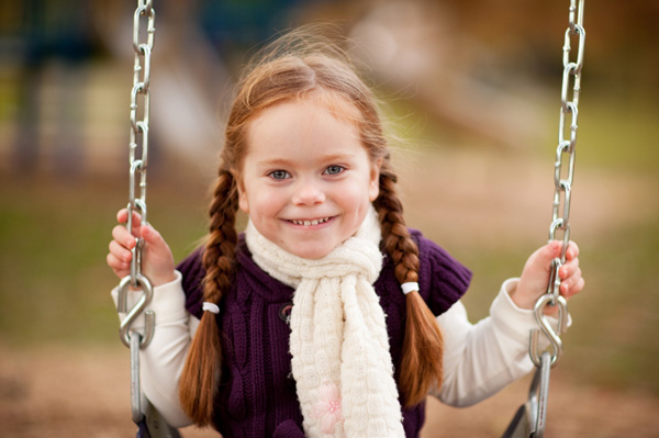 Little girl on fall playground