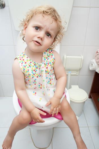Little girl on toliet