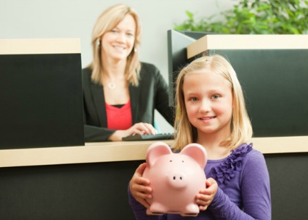 Girl with piggy bank at the bank