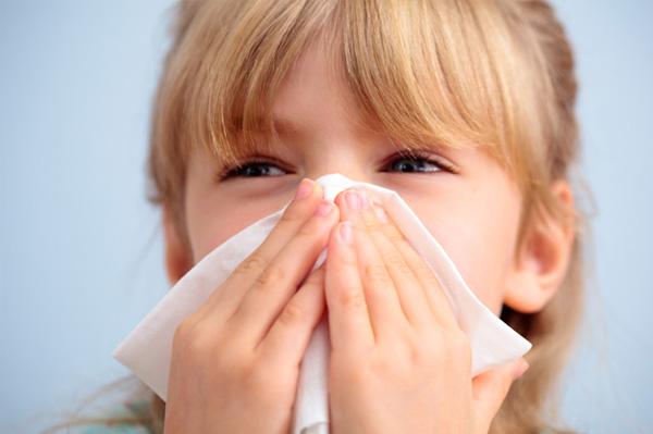 Girl sneezing during flu season