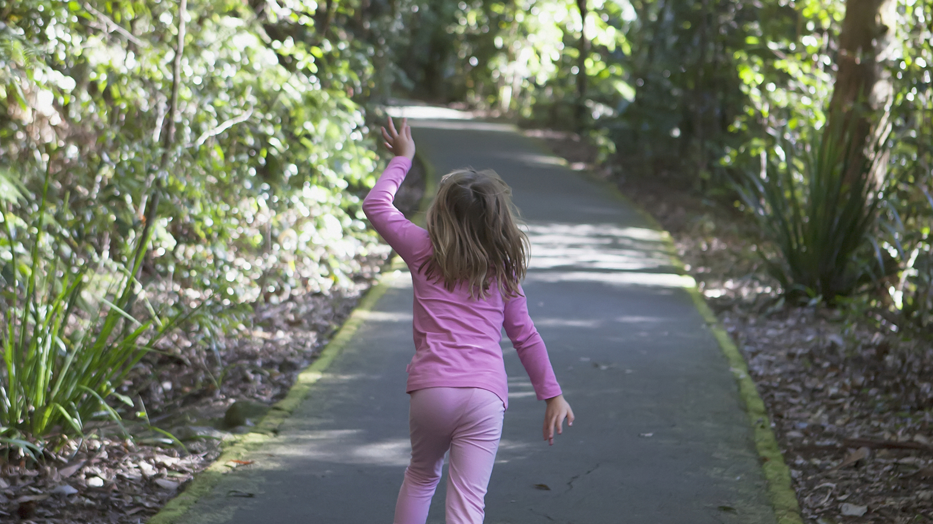 Little girl walking on path | Sheknows.com