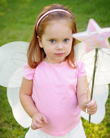 little girl wearing fairy wings