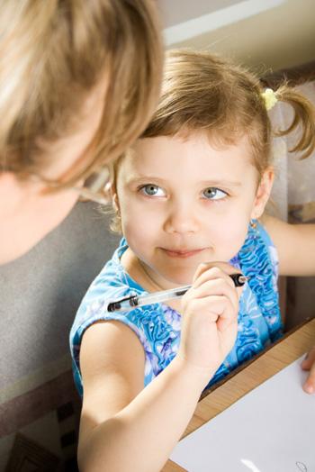 Little girl writing list