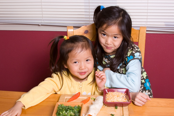 Little girls making sandwich