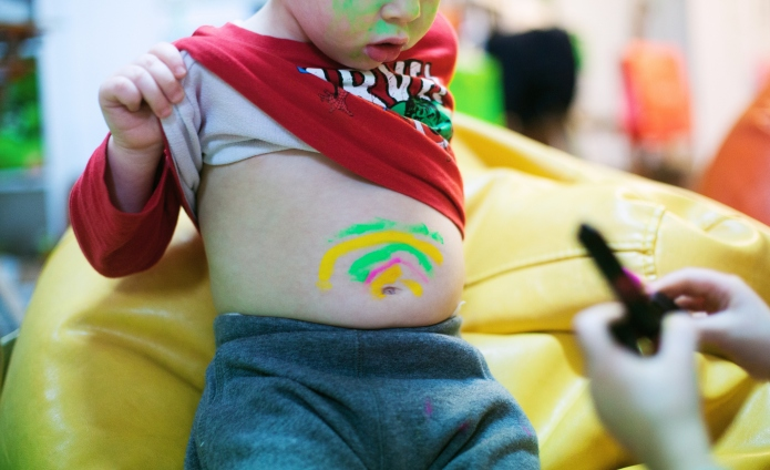 a little boy showing his painted