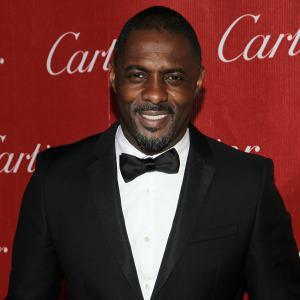 Idris Elba gets hot and heavy