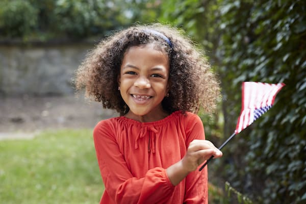 Girl waving little American flag
