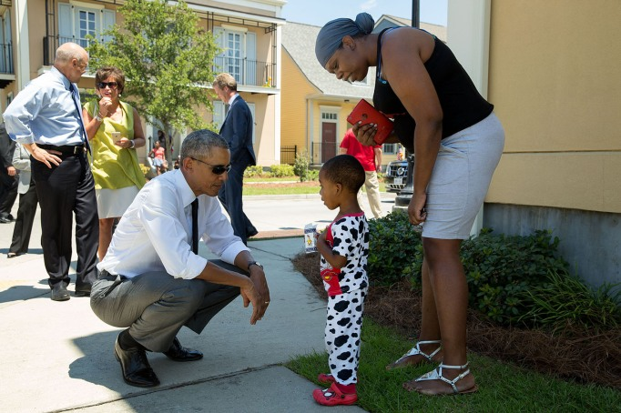 Obama with a child in pajamas