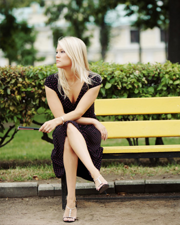 Lonley woman sitting on bench
