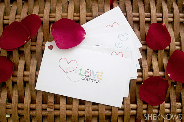 Love coupons with rose petals