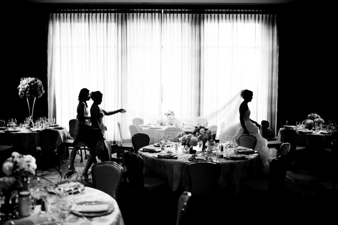 Wedding photo idea of bride checking the reception area
