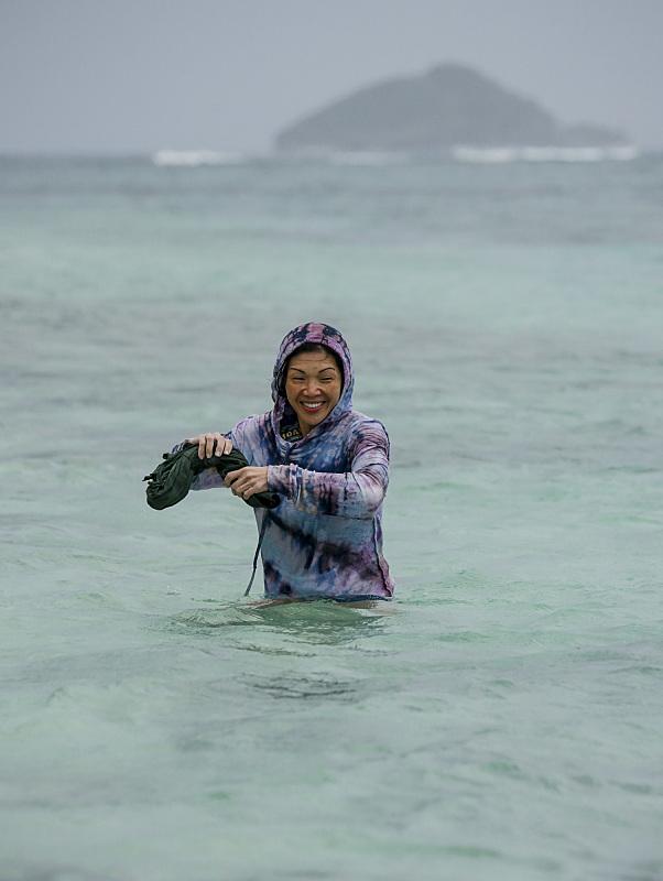 Lucy Huang in stormy weather on Survivor: Millennials Vs. Gen-X