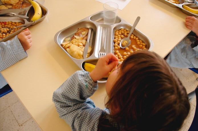 Schoolgirls eating. Focus on tray.More like