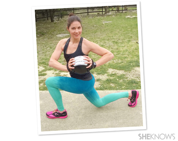 Walking lunge with twist holding a medicine ball