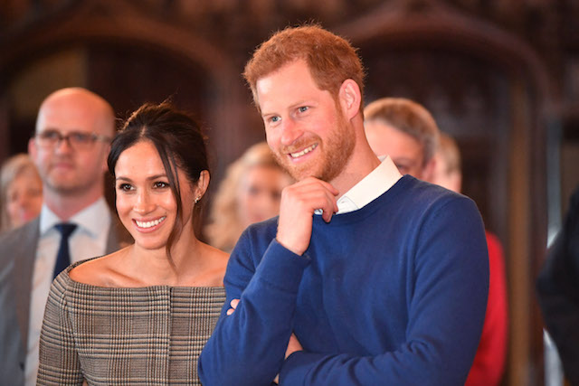 Meghan Markle and Prince Harry watch a performance during their visit to Cardiff Castle