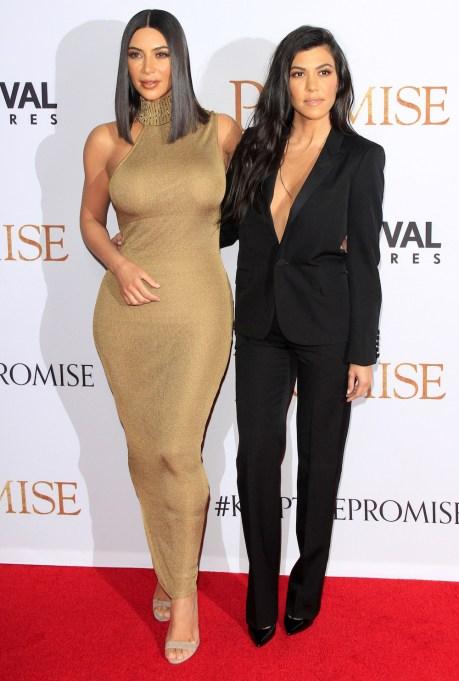 Kim and Kourtney Kardashian on red carpet