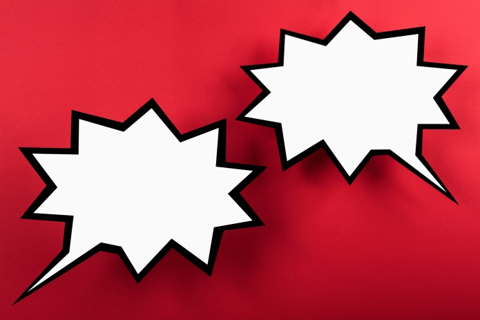 Blank exploding speech bubbles against red