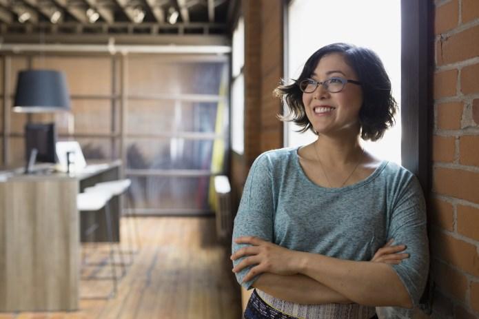Confident businesswoman looking away