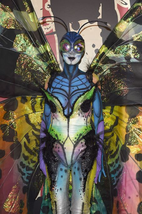 Heidi Klum dresses as a butterfly for Halloween in 2014