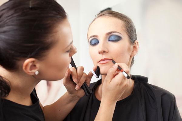 make-up artist applying make-up to model