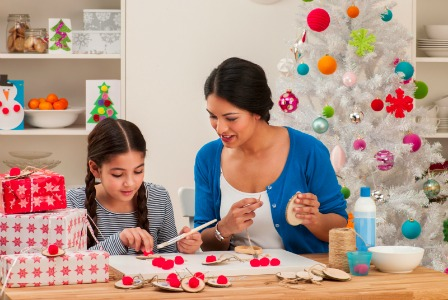 Mom and daughter making Christmas decorations