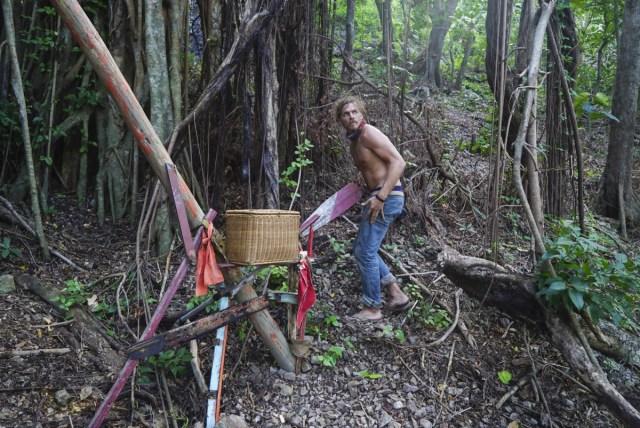 Malcolm Freberg wanders camp on Survivor: Game Changers