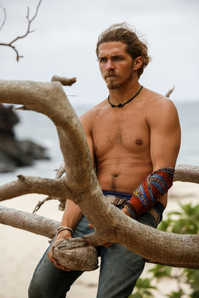 Malcolm Freberg sits at camp on Survivor: Game Changers