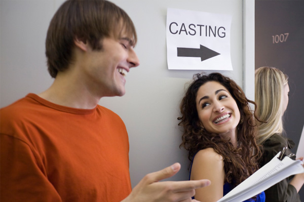 Man and woman at a casting audition