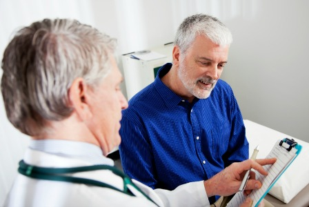 Man talking to doctor about prostate