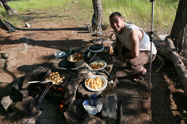 man cooking gourment campfire meal