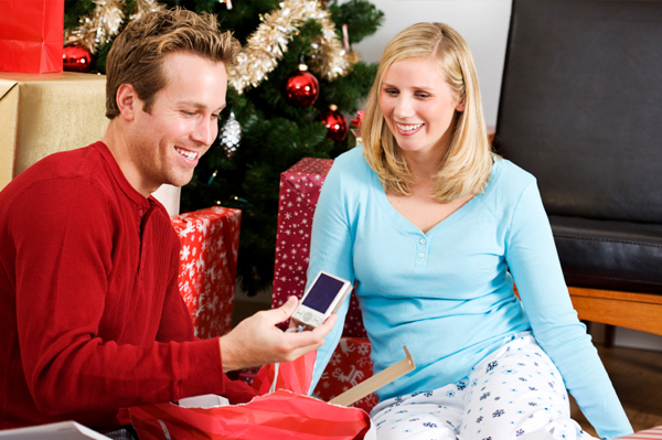Man receiving digital camera for Christmas