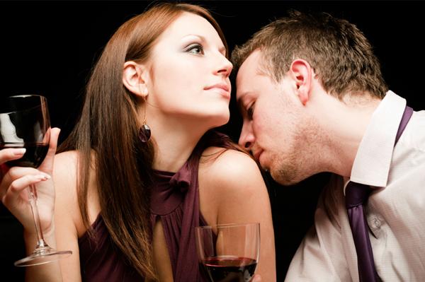 Man smelling woman