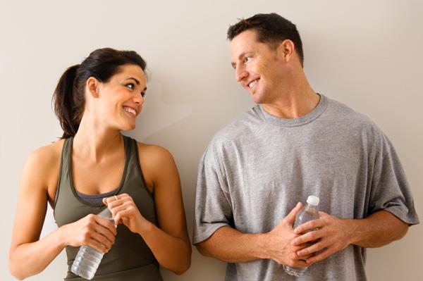 Man and woman flriting at gym