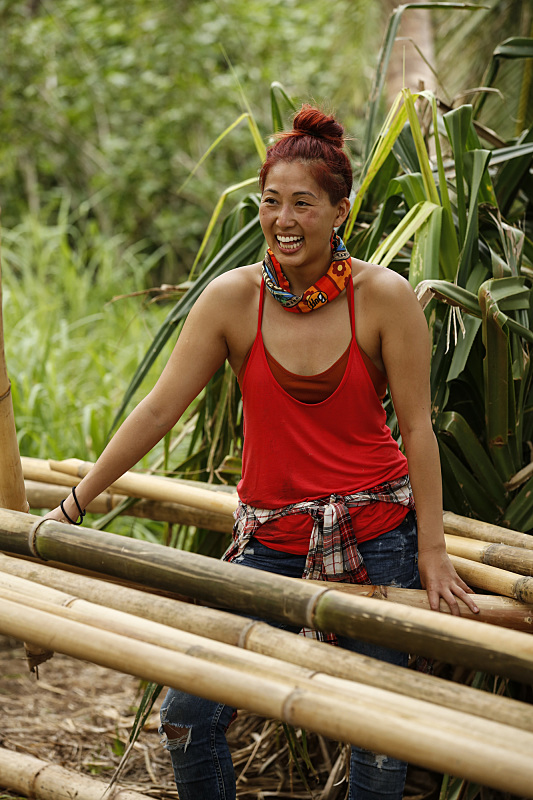 Mari Takahashi works on shelter during Survivor: Millennials Vs. Gen-X