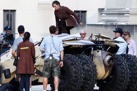 Marion Cotillard hops a batmobile