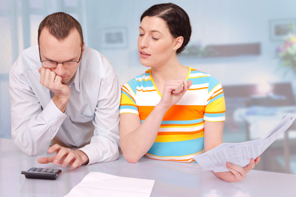 Couple going over home loan paperwork